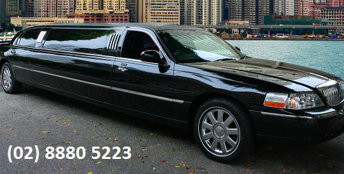 Very sleek looking black stretch limousine