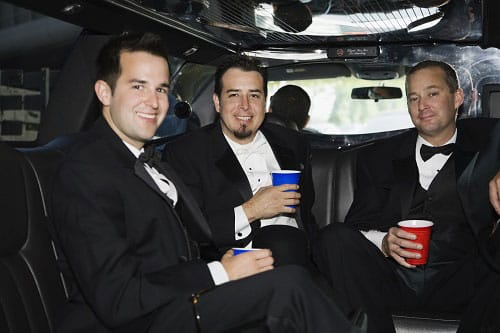 Group of Men in the back of a Limo on a Bucks Night
