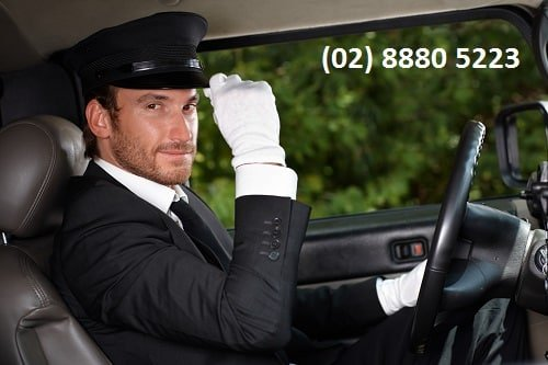 Sydney Chauffeur wearing white gloves and hat driving a Sydney Limo