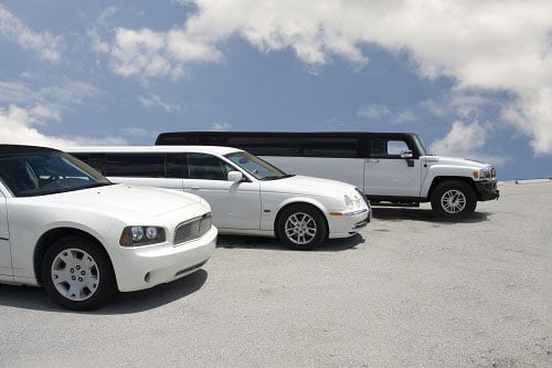 A mix of the Sydney Limo fleet options including a sedan, stretch limousine and stretch Hummer
